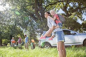 Multi-Generation Family Unpacking Car On Camping Trip © flairimages