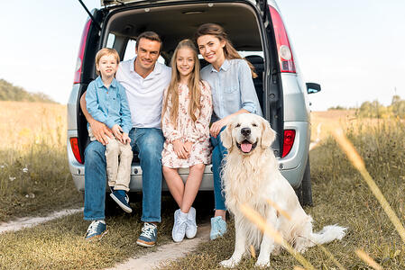 bigstock-Happy-Young-Family-With-Retrie-260554108