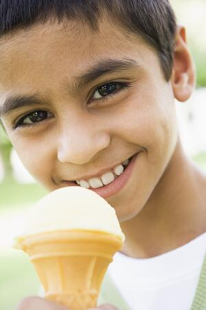 bigstock-Middle-Eastern-Child-Eating-Ic-3914345