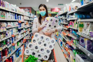 bigstock-Woman-Shopper-With-Mask-And-Gl-357299150