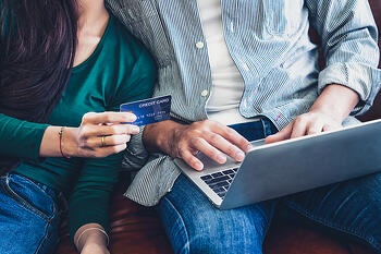 bigstock-Young-Couple-Use-Credit-Card-F-378238375