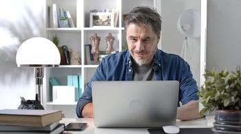 bigstock--s-man-working-online-with-la-404095130 (1)