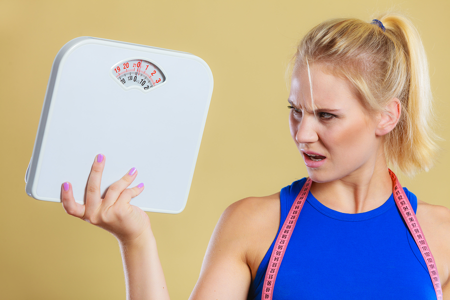 bigstock-Angry-Woman-With-Scale-Weight-153973838