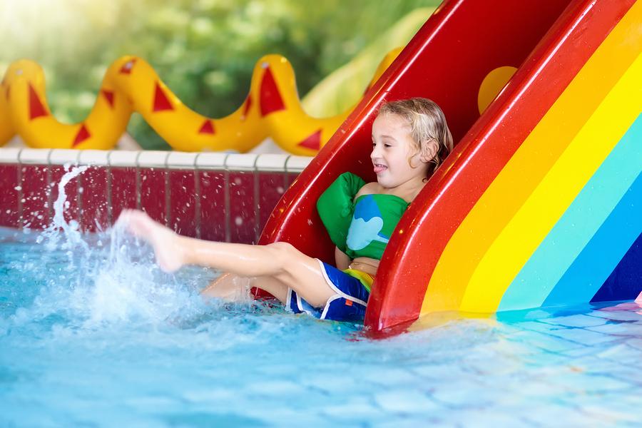 bigstock-Child-On-Swimming-Pool-Slide--235586884