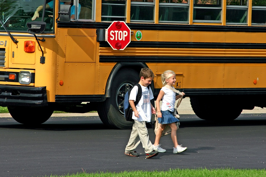 bigstock-Children-Getting-Off-The-Bus-874361
